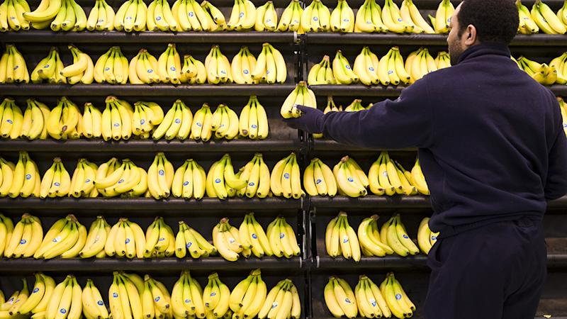 Bananas are seen stacked on a Woolworths' shelf.