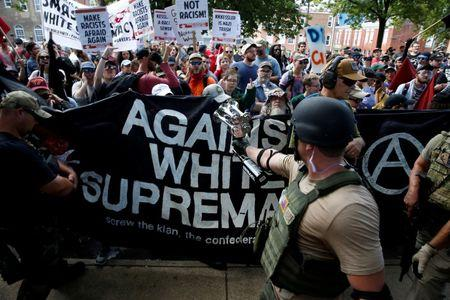Members of white nationalists are met by a group of counter-protesters in Charlottesville Virginia