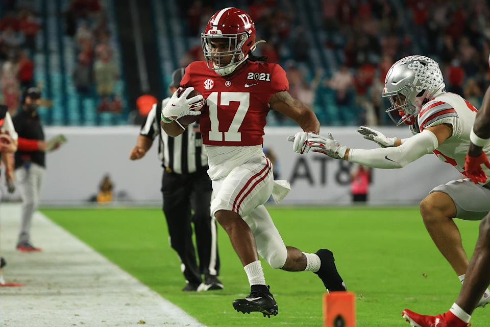 Alabama WR Jaylen Waddle hobbled out of bounds against the Ohio State Buckeyes in his first game back from injury on Monday. (Photo by Mike Ehrmann/Getty Images)