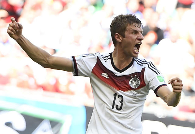 Germany's Thomas Mueller celebrates scoring his team's third goal, his second goal for the match, against Portugal during their 2014 World Cup Group G soccer match at the Fonte Nova arena in Salvador, June 16, 2014. REUTERS/Dylan Martinez (BRAZIL - Tags: SOCCER SPORT WORLD CUP)