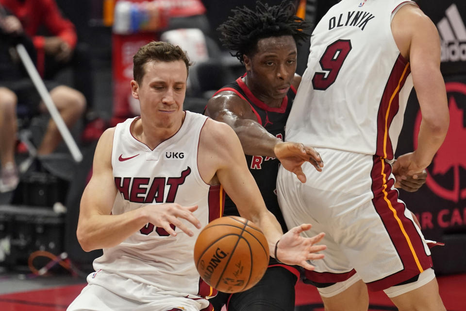 Toronto Raptors forward OG Anunoby (3) knocks the ball away from Miami Heat guard Duncan Robinson (55) during the second half of an NBA basketball game Friday, Jan. 22, 2021, in Tampa, Fla. (AP Photo/Chris O'Meara)