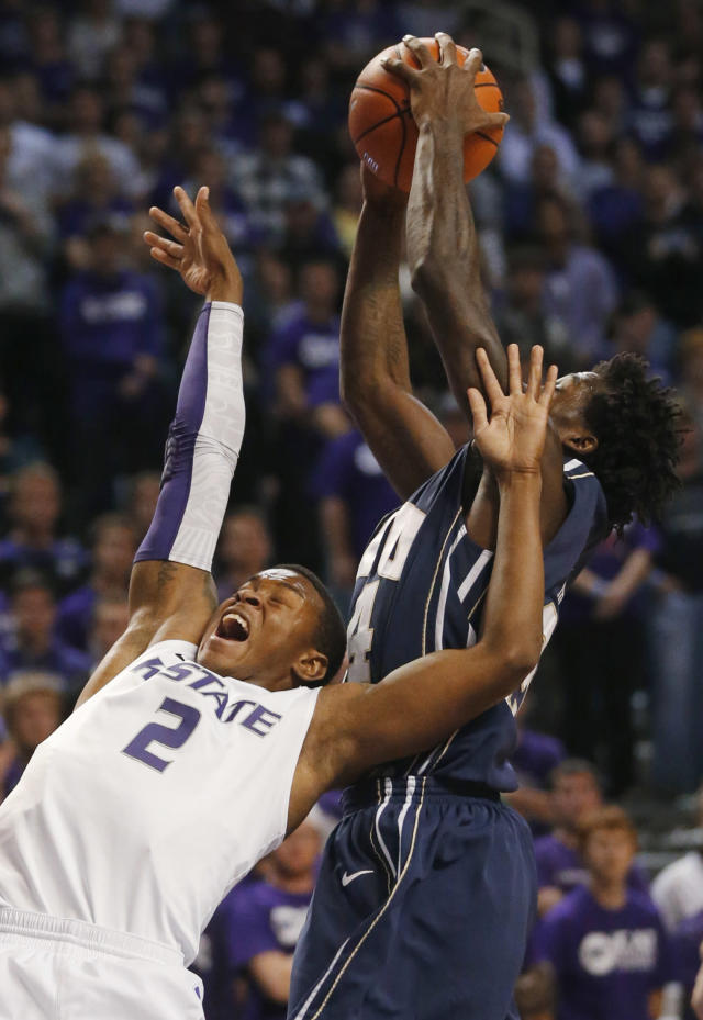 Oral Roberts guard Korey Billbury, back, reaches for a rebound over Kansas State guard Marcus Foster (2) during the first half of an NCAA college basketball game in Manhattan, Kan., Wednesday, Nov. 13, 2013. (AP Photo/Orlin Wagner)