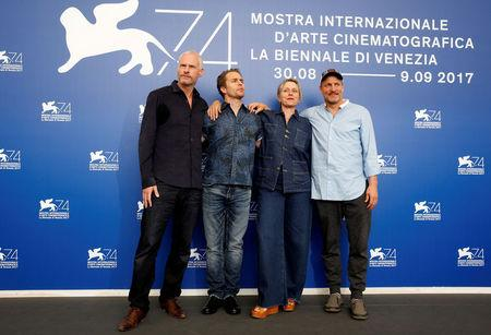 "FILE PHOTO: Director Martin McDonagh, actors Sam Rockwell, Frances McDormand and Woody Harrelson pose during a photocall for the movie ""Three Billboards Outside Ebbing, Missouri"" at the 74th Venice Film Festival in Venice, Italy September 4, 2017. REUTERS/Alessandro Bianchi/File Photo"