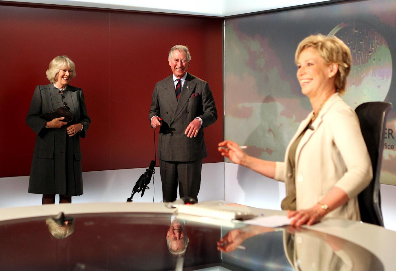 TV Newsreader Sally Magnusson reacts as Britain's Prince Charles prepares to read the weather forecast with Camilla Duchess of Cornwall, left, in the Six O'Clock studio whilst on a tour of the BBC Scotland Headquarters in Glasgow, Scotland, where they met staff to celebrate sixty years of BBC Scotland Television Thursday May 10, 2012. The fun royal reign assignment for Charles and Camilla might have revealed a lighthearted side to the royal couple. (AP Photo/Andrew Milligan, PA Wire) UNITED KINGDOM OUT
