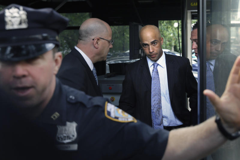 FILE - In this Sept. 21, 2015, file photo, James Blake, third from left, arrives at City Hall in New York. Blake says he never suspected the large man running toward him was a plainclothes New York City policeman. In the wake of George Floyd's death in Minneapolis, former tennis star James Blake says it's sad to see the type of policing that is still going on in America. Blake, who is black, was mistakenly identified as a suspect in a credit card fraud scheme in 2015, when an undercover New York City officer threw him to the sidewalk and handcuffed him. The experience intensified Blakes reaction to video of Floyds death shortly after being detained by Minneapolis police last week. (AP Photo/Seth Wenig, File)