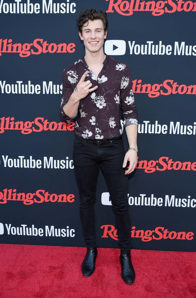 <p>Shawn Mendes opted for a floral shirt and skinny jeans for Rolling Stone's relaunch event on 26 July. Seriously though, where can we bag that killer shirt?! <em>[Photo: Getty]</em> </p>