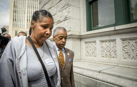 Rev. Al Sharpton (R) and Esaw Garner, wife of Eric Garner who died after being put in a choke hold by a New York City police officer, arrive to meet with Brooklyn U.S. Attorney Loretta Lynch, at her offices in the Brooklyn borough of New York, August 21, 2014.  REUTERS/Brendan McDermid