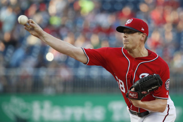 FILE - In this Saturday, Aug. 4, 2018 file photo, Washington Nationals starting pitcher Jeremy Hellickson throws during the first inning of the second baseball game of the team's doubleheader against the Cincinnati Reds at Nationals Park in Washington. A person familiar with the negotiations says that right-hander Jeremy Hellickson and the Washington Nationals have agreed in principle to a $1.3 million, one-year contract. The person spoke to The Associated Press on condition of anonymity Wednesday, Feb. 6, 2019 because the deal was subject to a successful physical exam. (AP Photo/Alex Brandon, File)