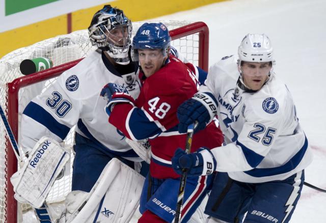 Montreal Canadiens' Daniel Briere gets caught between Tampa Bay Lightning goalie Ben Bishop and Lightning's Matt Carle during the first period of an NHL hockey game Tuesday, Nov. 12, 2013, in Montreal. (AP Photo/The Canadian Press, Paul Chiasson)