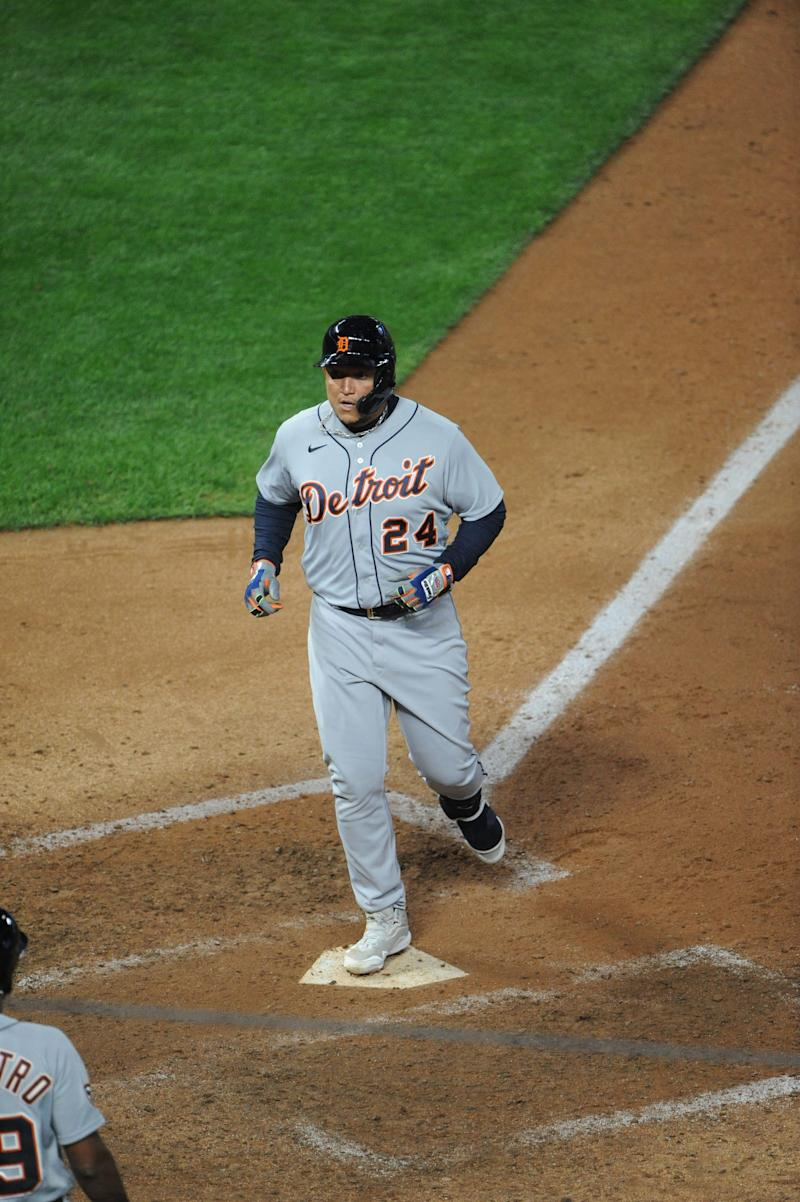 Detroit Tigers designated hitter Miguel Cabrera (24) hits a two-run homer during the ninth inning against the Minnesota Twins on Sept. 23, 2020, at Target Field.