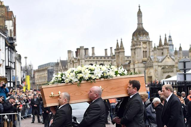 <p>The coffin of Professor Stephen Hawking arrives at University Church of St Mary the Great as mourners gather to pay their respects, in Cambridge, England, Saturday March 31, 2018. The renowned British physicist died peacefully on March 14 at the age of 76. (Photo: Joe Giddens/PA via AP) </p>