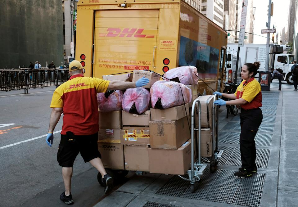 DHL employees prepare packages for delivery near Times Square in Manhattan, New York City, New York, United States, June 13, 2016. REUTERS / Rickey Rogers