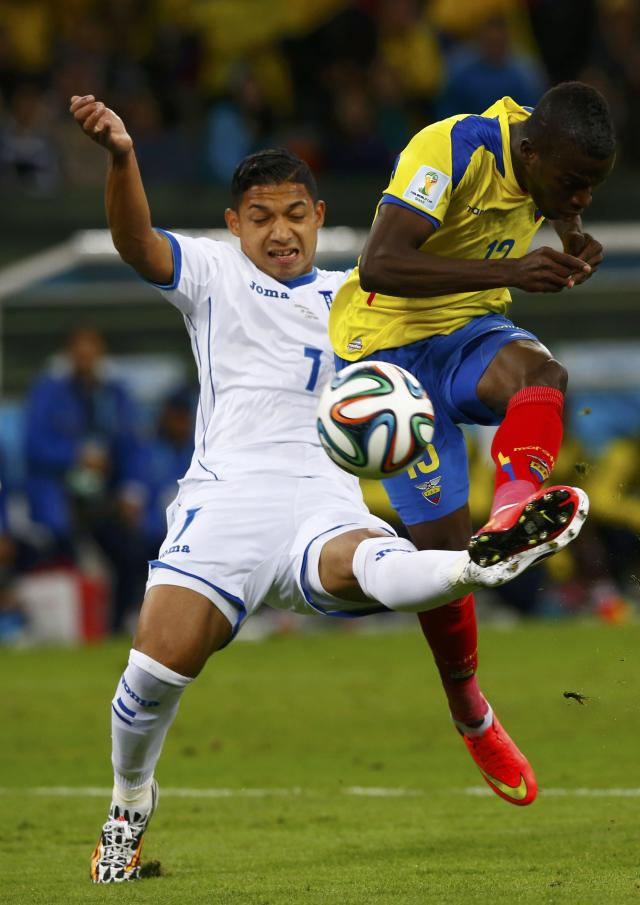 Emilio Izaguirre of Honduras fights for the ball with Ecuador's Enner Valencia (R) during their 2014 World Cup Group E soccer match at the Baixada arena in Curitiba June 20, 2014. REUTERS/Darren Staples (BRAZIL - Tags: SOCCER SPORT WORLD CUP)