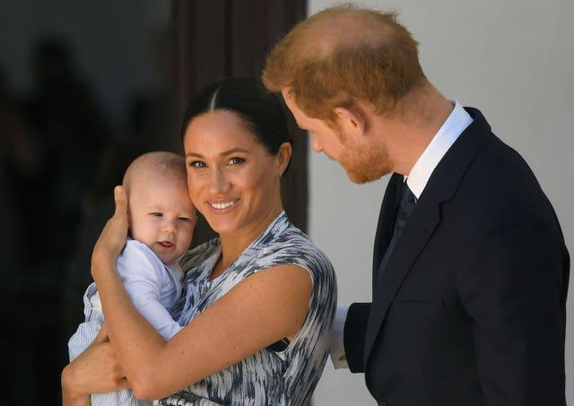 Harry with Archie and Meghan