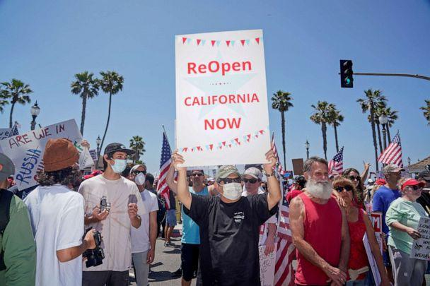 PHOTO: People gather near Huntington Beach Pier to protest Gov. Gavin Newsom's order to temporarily close state and local beaches in Orange County, during the outbreak of the coronavirus virus, in Huntington Beach, California, U.S., May 1, 2020. (Kyle Grillot/Reuters)