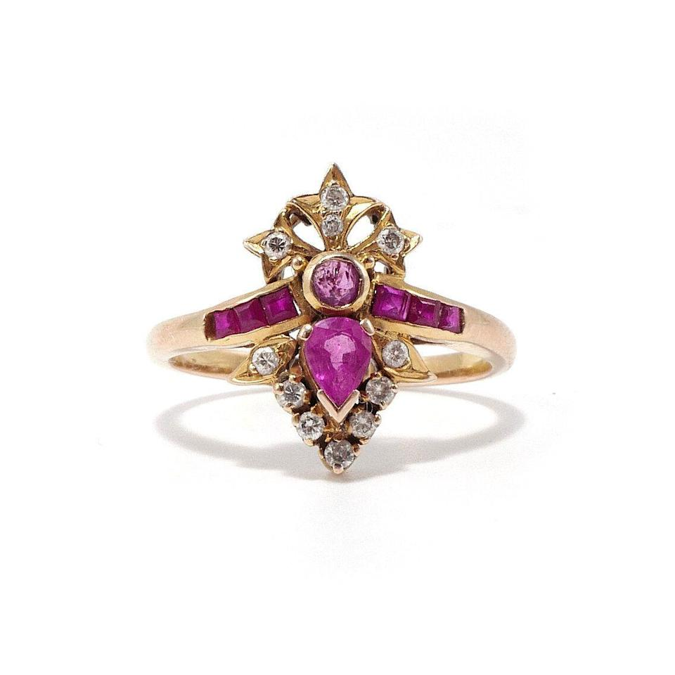"<p>With a crown motif of vibrant rubies, this vintage ring is for the fashion-forward bride whose looking to layer her engagement ring with a mix of various gold and diamond bands on neighboring fingers, and who loves the look of an antique piece rather than something super shiny and new. </p><p><em>Vintage ""Isla"" ring, $1,250, <a href=""https://ashleyzhangjewelry.com/vintage/isla-ruby-and-diamond-ring?rq=ruby"" rel=""nofollow noopener"" target=""_blank"" data-ylk=""slk:ashleyzhangjewelry.com"" class=""link rapid-noclick-resp"">ashleyzhangjewelry.com</a>.</em></p><p><a class=""link rapid-noclick-resp"" href=""https://ashleyzhangjewelry.com/vintage/isla-ruby-and-diamond-ring?rq=ruby"" rel=""nofollow noopener"" target=""_blank"" data-ylk=""slk:SHOP"">SHOP</a></p>"