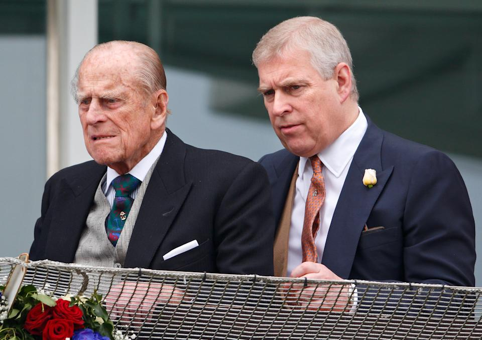 Prince Andrew and Prince Philip wearing suits together