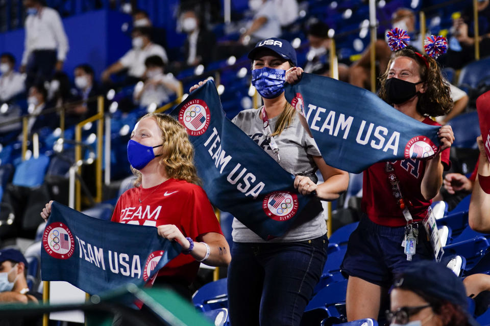 Fans of team United States cheer during a softball game against Japan at the 2020 Summer Olympics, Tuesday, July 27, 2021, in Yokohama, Japan. (AP Photo/Matt Slocum)