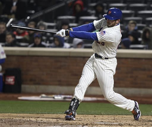 New York Mets' Ike Davis swings on a two-run home run in the fifth inning in a baseball game against the San Diego Padres on Wednesday, April 3, 2013, in New York. (AP Photo/Peter Morgan)