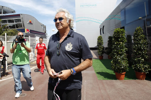 Former F1 team executive Briatore in hospital with virus