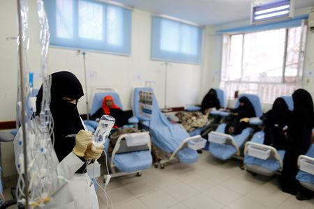 A nurse prepares drug for female patients at a cancer treatment center in Sanaa, Yemen, February 11, 2017. REUTERS/Khaled Abdullah