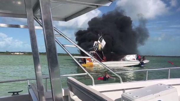 People on a neighboring boat attempted to rescue injured passengers from the explosion off Exuma in the Bahamas on Saturday, June 30, 2018. (SCV/Skyline Media)
