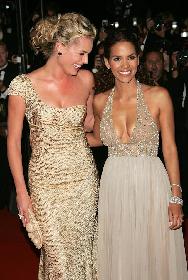 <p>Berry and Rebecca Romijn are all smiles at the Cannes Film Festival premiere. Although Berry reprised her role as Storm in <em>Days of Future Past</em>, the role of Storm has been taken over by Alexandra Shipp for <em>X-Men: Apocalypse</em> and 2018's <em>X-Men: Dark Phoenix</em>.<br> (Photo: Getty Images) </p>