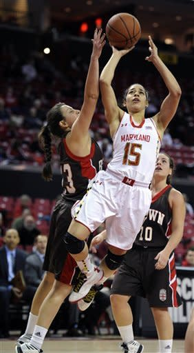 Maryland's Chloe Pavlech (15) shoots as Brown's Natalie Ball blocks during the second half of an NCAA women's college basketball game, Friday, Dec. 28, 2012, in College Park, Md. Maryland won 76-36. (AP Photo/Gail Burton)