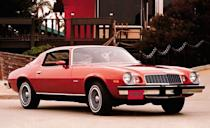 """<p>With the excision of the Z/28, the most exciting thing about the 1975 Camaro was the new wraparound rear window that slightly—very slightly—increased rear visibility. This was the first year for catalytic converters, and the output of Camaro engines skidded downward. The six could wheeze out only 105 horsepower while the """"big"""" 350 V-8 was rated at a miserable 145 horsepower when equipped with a two-barrel carburetor or 155 horsepower in California and high-altitude areas where a four-barrel arrested the decline.</p>"""