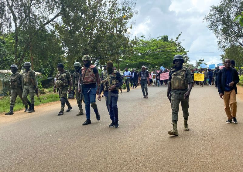Schoolchildren, their parents and teachers hold a protest after gunmen opened fire at a school, killing at least six children as authorities claim, in Kumba