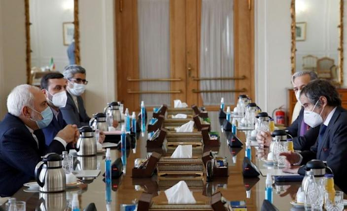 Iran's Foreign Minister Mohammad Javad Zarif (left) meets with the director general of the International Atomic Energy Agency, Rafael Grossi, in Tehran on February 21, 2021 as they reach a compromise