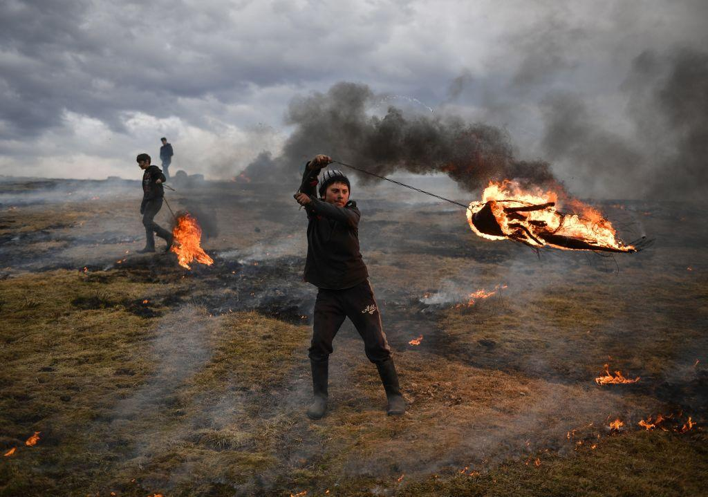 "<p>A youth spins a flaming tire as part of a tradition marking the upcoming Clean Monday, the first day of Great Lent in the Eastern Orthodox Christian church calendar, on March 10, 2019 in the Romanian village of Poplaca. This annual ""Clean Monday"" ritual, is designed to ward off evil spirits before the onset of Lent on Monday, which marks the beginning of 40 days of abstention, when Orthodox Christians cut out meat, fish, eggs, and dairy. (Photo from Daniel Mihailescu/AFP/Getty Images) </p>"