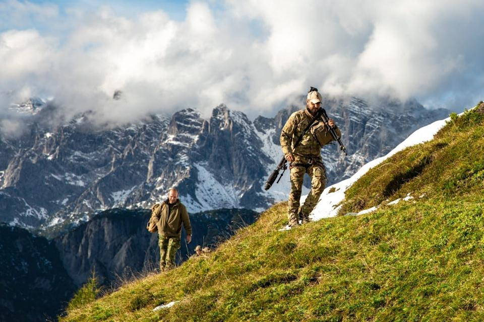 An Italian Special Forces Sniper and International Special Training Center Sniper instructor moving off the range.