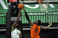 Oregon State forward Warith Alatishe (10) blocks the shot of Oregon forward Eugene Omoruyi (2) during the first half of an NCAA college basketball game Saturday, Jan. 23, 2021, in Eugene, Ore. (AP Photo/Andy Nelson)