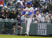 New York Mets starting pitcher Marcus Stroman points to his glove after stopping a ground ball off the bat of Colorado Rockies' Josh Fuentes in the eighth inning of a baseball game Sunday, April 18, 2021, in Denver. (AP Photo/David Zalubowski)