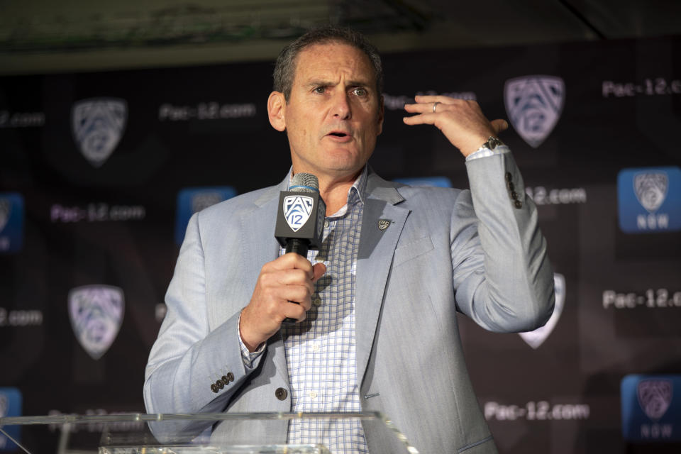 """FILE - In this Oct. 8, 2019, file photo, commissioner Larry Scott speaks during the Pac-12 NCAA college basketball media day, in San Francisco. The commissioners of the Atlantic Coast Conference, Big Ten, Big 12, Pac-12 and Southeastern Conference say they have been in almost constant contact since the NCAA men's basketball tournament was canceled on March 12."""" Based on the very positive and close collaboration among the leaders in college football and discussions with schools, other leagues and the medical community, at this point in time we are planning to start the football season on time and together on a national basis,"""" Pac-12 Commissioner Larry Scott said. (AP Photo/D. Ross Cameron, File)"""
