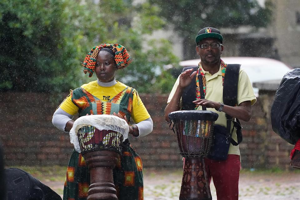 People played drums during the event in Max Roach park. (Steve Parsons/PA) (PA Wire)