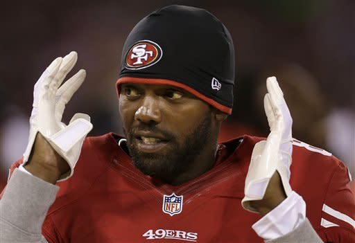 San Francisco 49ers wide receiver Randy Moss stands on the sideline during the second half of an NFL preseason football game against the San Diego Chargers in San Francisco, Thursday, Aug. 30, 2012. (AP Photo/Marcio Jose Sanchez)