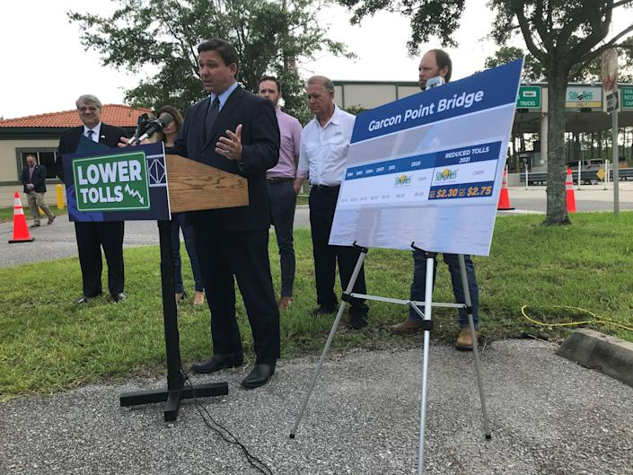Florida Gov. Ron DeSantis speaks at a press conference Wednesday, July 28, 2021, at the Garcon Point Bridge to announce that the state is lowering the tolls and will begin the process of purchasing the bridge from the bondholders.