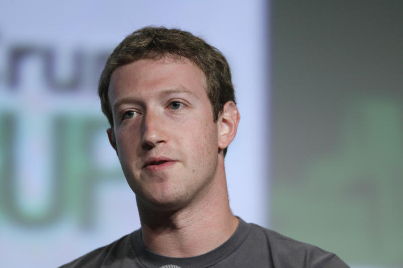 """In this Sept. 11, 2012 photo, Facebook CEO Mark Zuckerberg speaks during a """"fireside chat"""" at a conference organized by technology blog TechCrunch in San Francisco.  Zuckerberg updated his Facebook status on Thursday, Oct. 4, 2012,  to announce that the social networking site has more than 1 billion active users each month. He thanked users and said that he is committed to making Facebook better. The Menlo Park, Calif.-based company has had a difficult time of late. There were trading glitches the day it went public in May and concerns since then about its revenue potential. It's also facing lawsuits from disgruntled shareholders.(AP Photo/Eric Risberg)"""