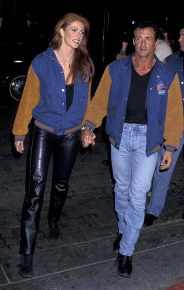 Sly's busy year apart from Jennifer Flavin (from March 1994 to the summer of 1995) included a brief engagement to Angie Everhart, who is pictured with the actor (in matching jackets) at a Planet Hollywood event in 1995. (Photo: Jim Smeal/WireImage)