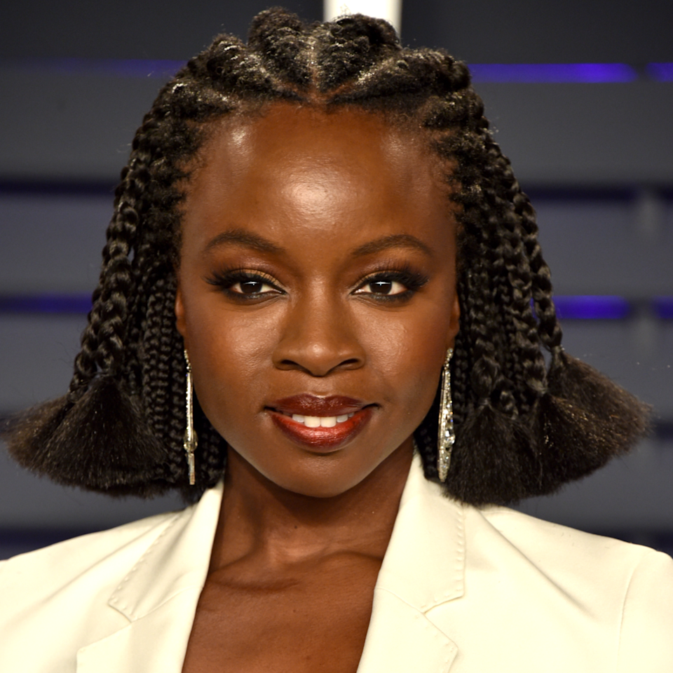 "No stranger to making a beauty statement whenever she hits a red carpet, <em>Black Panther</em> star Danai Gurira showed out at the 2019 Vanity Fair Oscar after party rocking an otherworldly braided look. Her hair was cornrowed in the front, with box braids underneath. She <a href=""https://www.allure.com/gallery/oscars-2019-red-carpet-best-hairstyles-makeup?mbid=synd_yahoo_rss"">showed up to the Oscars ceremony</a> with braids that reached to her butt, but for the after party, hairstylist <a href=""https://www.instagram.com/larryjarahsims/"">Larry Sims</a> cut her braids, leaving them undone at the bottom and secured with elastics. It's the kind of hairstyle that would be right at home in Wakanda."