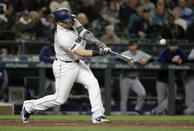 Seattle Mariners Mike Zunino hits a walk-off solo home run against the Minnesota Twins during the 12th inning of a baseball game, Saturday, May 26, 2018, in Seattle. The Mariners won 4-3. (AP Photo/Ted S. Warren)
