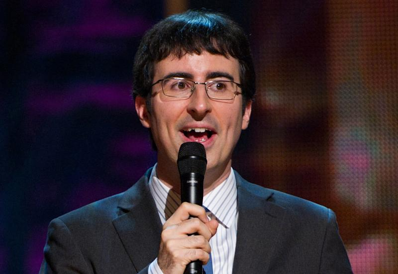"""FILE - In this Oct. 2, 2010 file photo, John Oliver appears on stage at Comedy Central's 'Night Of Too Many Stars: An Overbooked Concert For Autism Education' at the Beacon Theatre in New York. Starting Monday, June 10, 2013, Oliver will preside on """"The Daily Show"""" on Comedy Central. He will substitute-anchor for eight weeks of new shows before Jon Stewart's return on Sept. 3. (AP Photo/Charles Sykes)"""