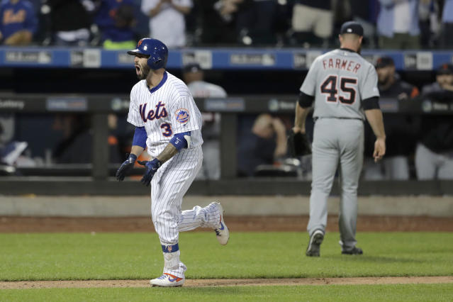 New York Mets' Tomas Nido, left, runs home after hitting a walk-off solo home run off Detroit Tigers relief pitcher Buck Farmer (45) during the 13th inning of a baseball game Saturday, May 25, 2019, in New York. The Mets won 5-4. (AP Photo/Julio Cortez)