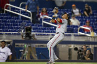 Washington Nationals second baseman Starlin Castro (13) laughs as he catches a pop fly during the ninth inning of a baseball game against the Miami Marlins on Thursday, June 24, 2021, in Miami. (AP Photo/Mary Holt)