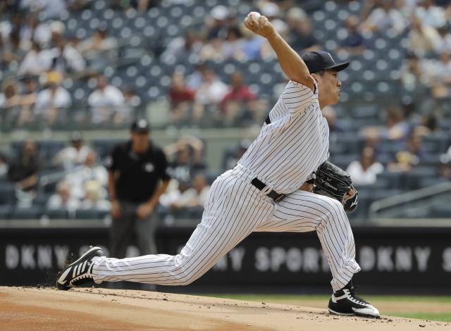 New York Yankees' Masahiro Tanaka, of Japan, delivers a pitch during the first inning of a baseball game against the Arizona Diamondbacks Wednesday, July 31, 2019, in New York. (AP Photo/Frank Franklin II)