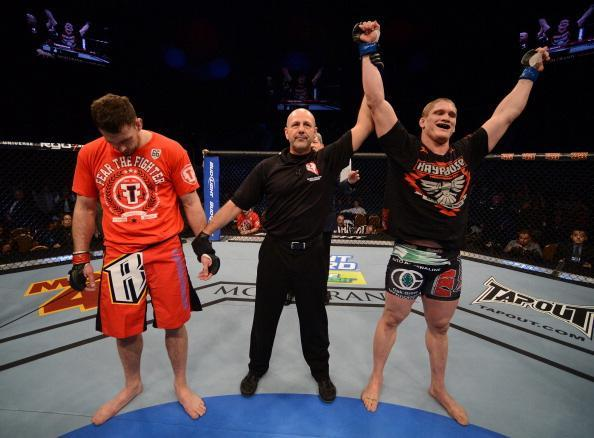 LAS VEGAS, NV - DECEMBER 29: Todd Duffee (right) is declared the winner over Phil De Fries (left) after their heavyweight fight at UFC 155 on December 29, 2012 at MGM Grand Garden Arena in Las Vegas, Nevada. (Photo by Donald Miralle/Zuffa LLC/Zuffa LLC via Getty Images)