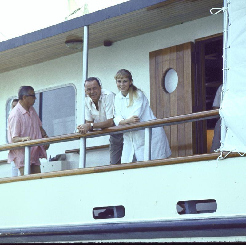 """<p>Frank Sinatra and Mia Farrow lean on the banister of a yacht in 1965, which <a href=""""https://www.nytimes.com/1965/08/05/archives/sinatra-on-cruise-with-mia-farrow.html"""" rel=""""nofollow noopener"""" target=""""_blank"""" data-ylk=""""slk:caused quite the media storm"""" class=""""link rapid-noclick-resp"""">caused quite the media storm</a> and rumors they would soon marry. The couple tied the knot in Las Vegas a year later. </p>"""