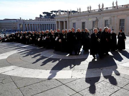 FILE PHOTO: Members of the Order of the Knights of Malta arrive in St. Peter Basilica for their 900th anniversary at the Vatican